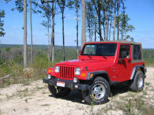 2002 Jeep Wrangler Sport in Flame Red